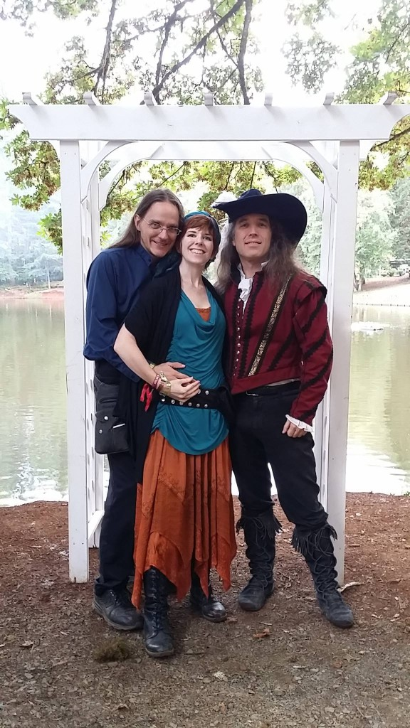 Tamra with her partners Kevin (left) and Craig (right) at FaerieWorlds 2015.